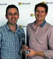 Peter and nSynergy Principal Consultant Daniel Goss collecting the 2013 Microsoft Collaboration & Content Partner of the Year trophy on 20 August.